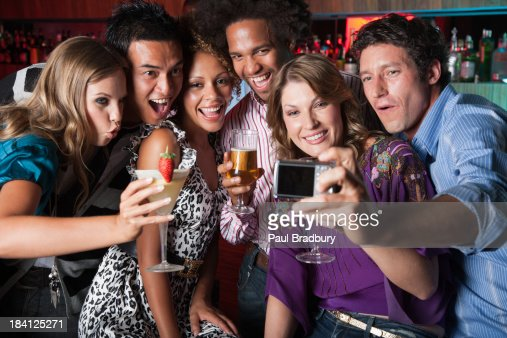 Friends at a club taking pictures : Stock Photo