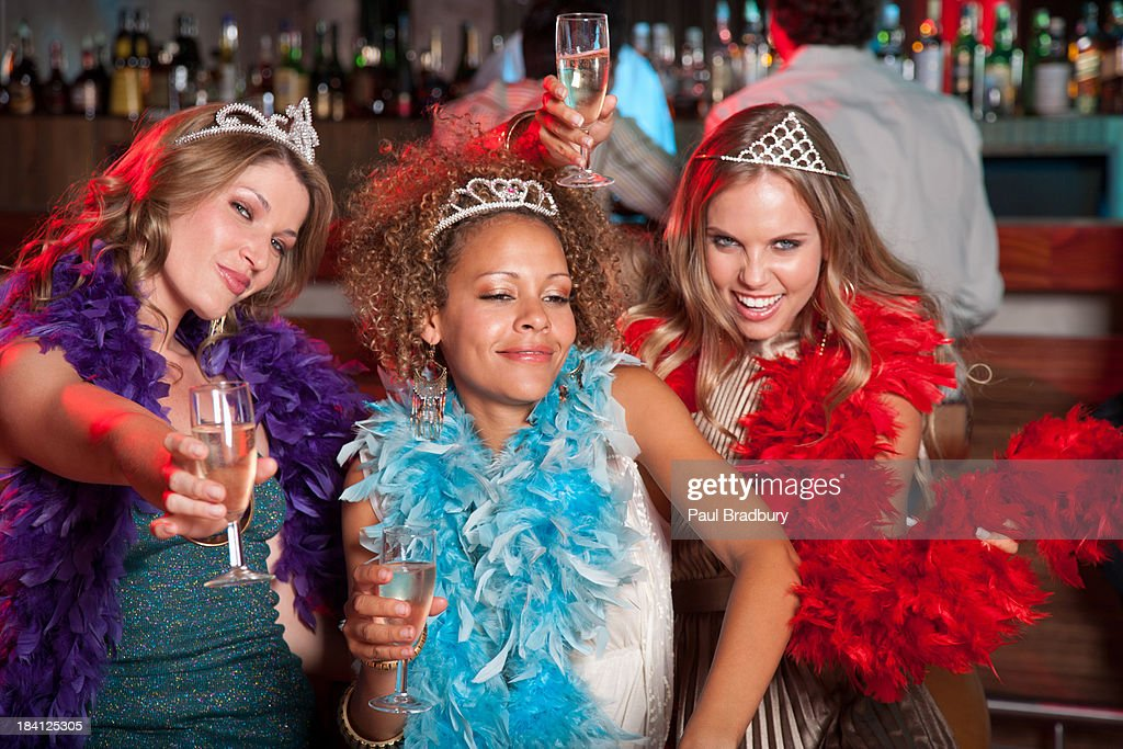 Friends at a club with drinks : Stock Photo