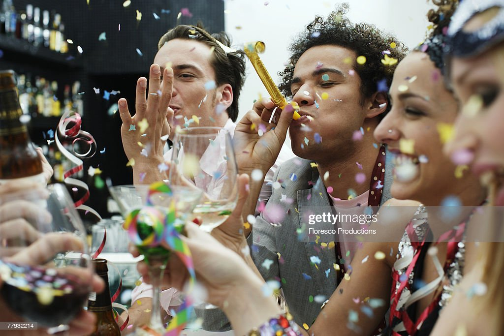 Friends at a party with confetti : Stock Photo
