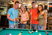 Friends at a pool hall
