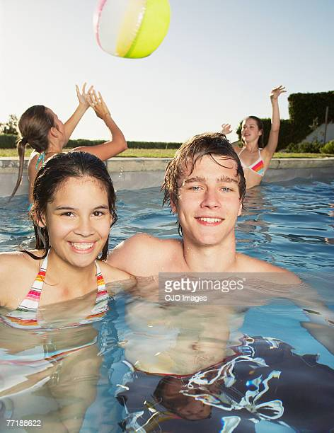 Friends at a pool having fun