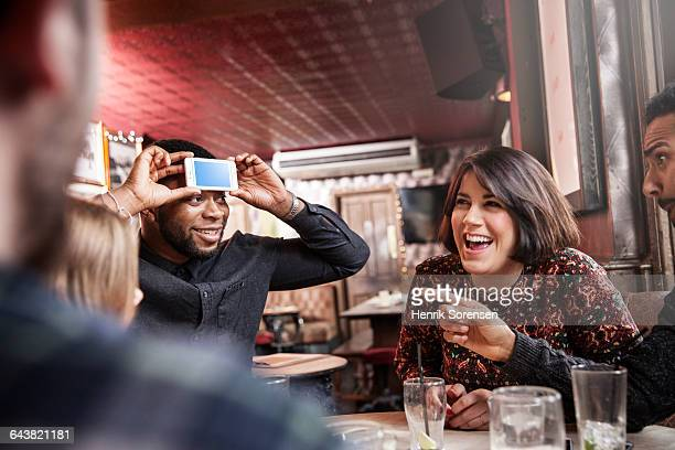 friends at a pub, playing games, laughing