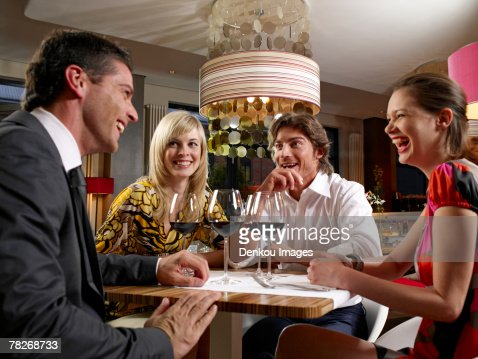 Friends at a restaurant. : Stock Photo