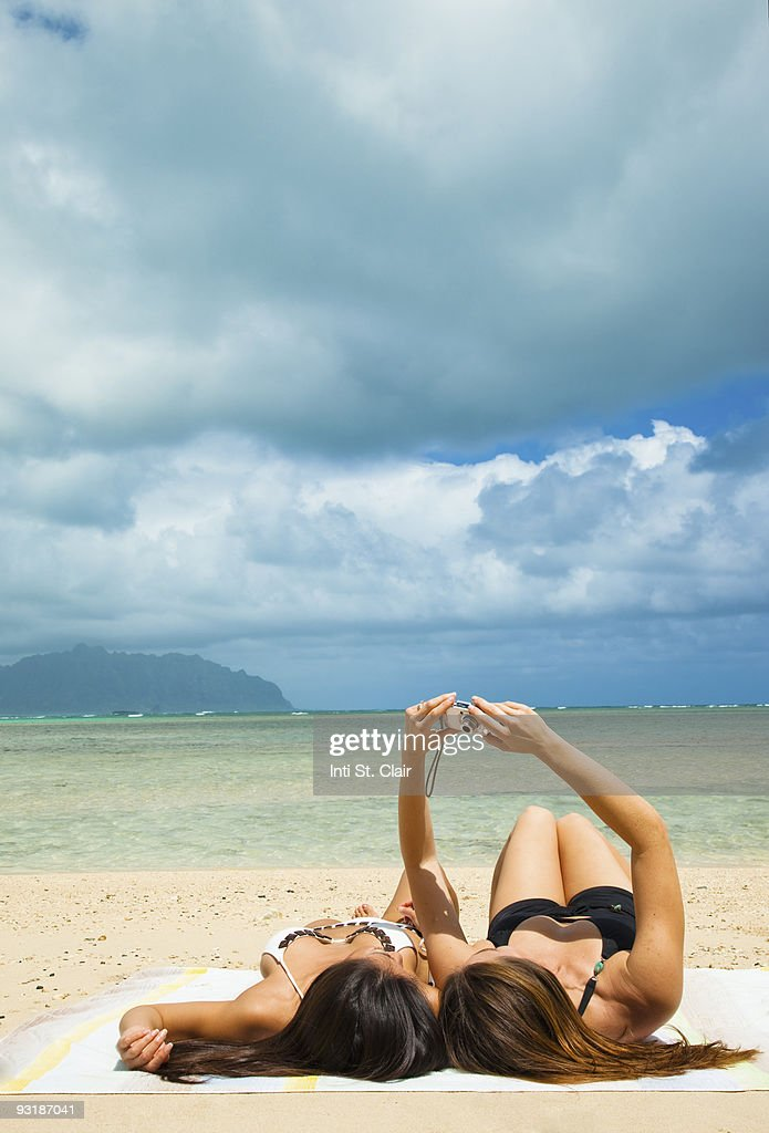 Friends at beach taking self portrait with camera : Stock Photo