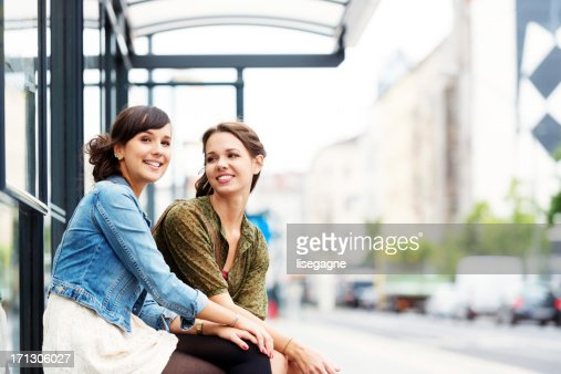 Friends at bus stop