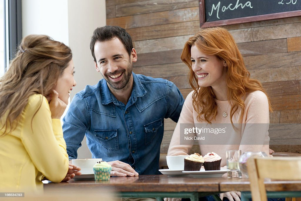 Friends at cafe bar : Stock Photo