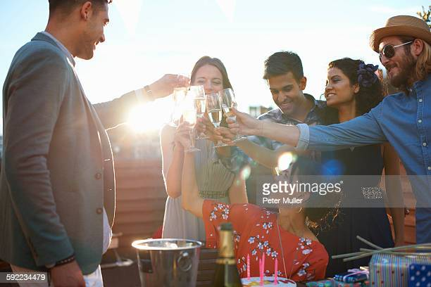Friends at outdoor party making a toast