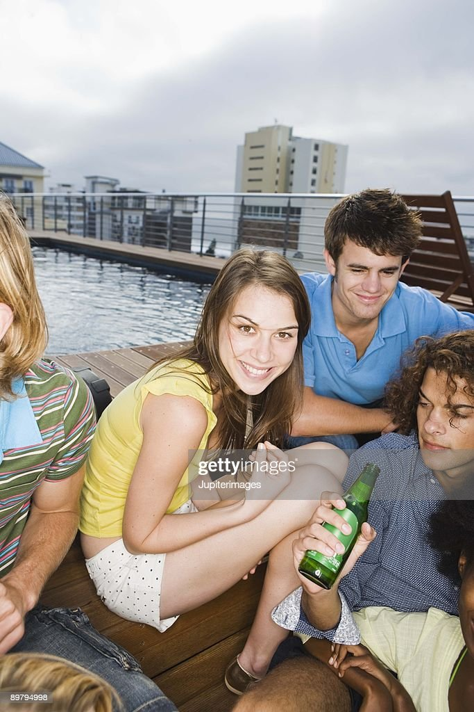 Friends at poolside party : Stock Photo