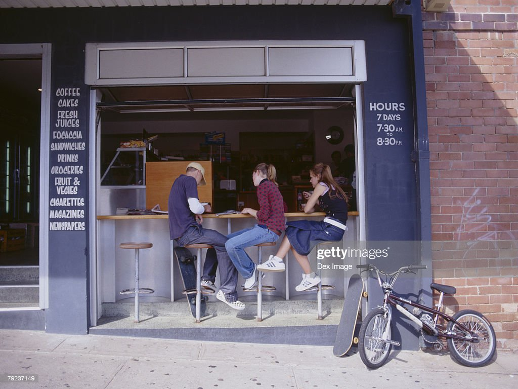 Friends at sidewalk caf? : Stock Photo