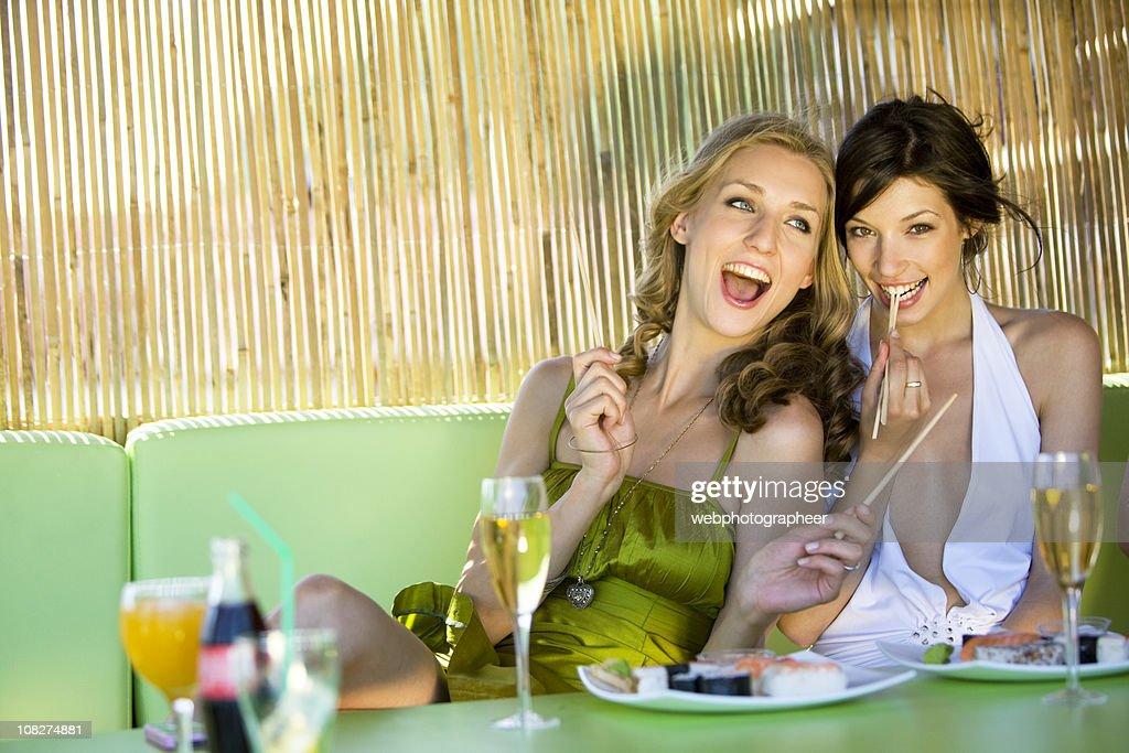 Friends at sushi bar : Stock Photo