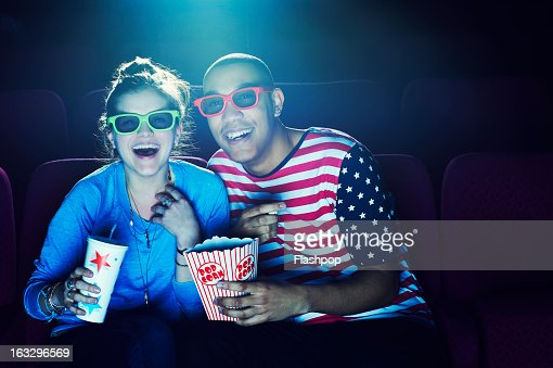 Friends at the cinema wearing 3D glasses
