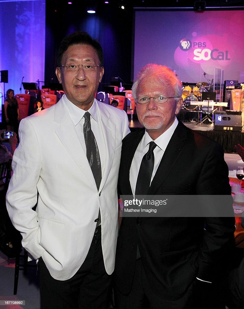 JT & Friends band leader and Co-Founder of Kingston Technologies, John Tu and President of CEO of PBS SoCaL, Mel Rogers (R) attend the PBS SoCaL 2013 'A Lifetime of Learning' Gala at the Atlantic Aviation Hangar at John Wayne Airport on April 27, 2013 in Santa Ana, California.