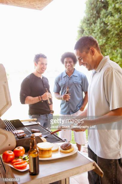 Friends barbecuing together