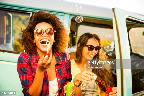 Friends blowing bubbles on roadtrip