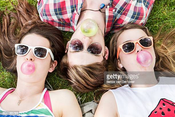 friends blowing chewing  gum bubbles