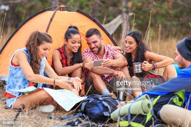 Friends camping in nature