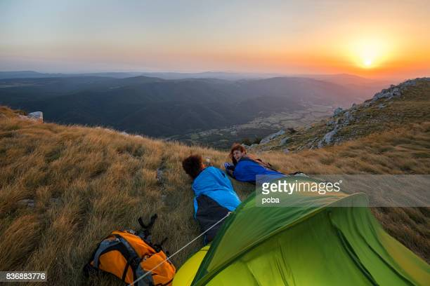 Friends camping on mountain