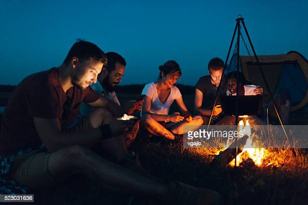 Friends camping together in nature