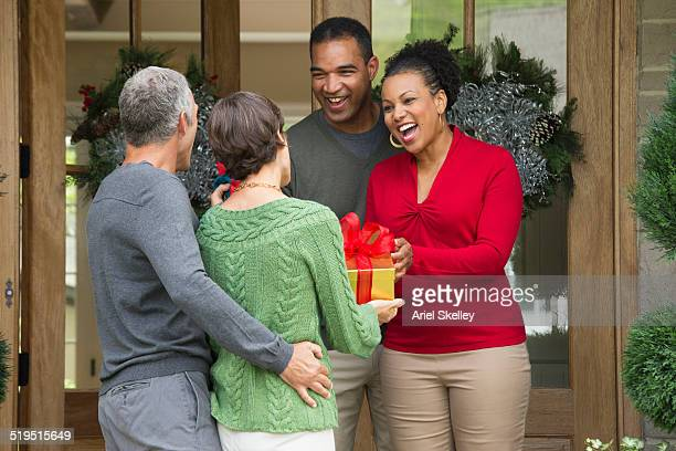 Friends carrying Christmas gifts