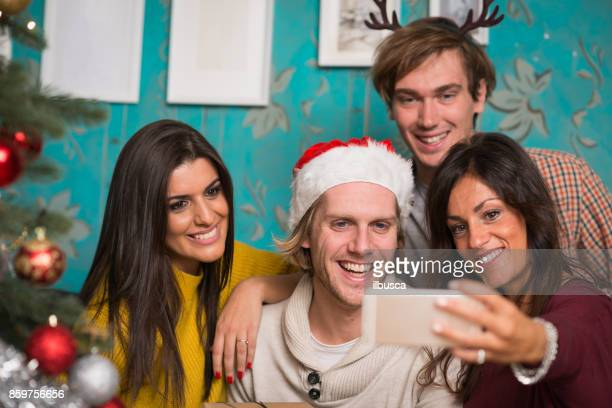 Friends celebrating Christmas: Smartphone selfie
