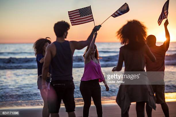 Friends celebrating independence day on the beach