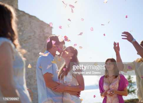 Friends celebrating newlywed couple : Stock Photo