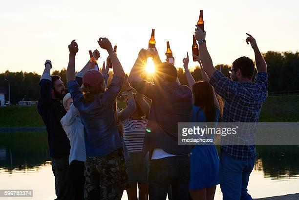 Friends Celebrating on Lake Coast