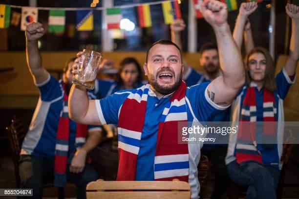 Friends celebrating victory