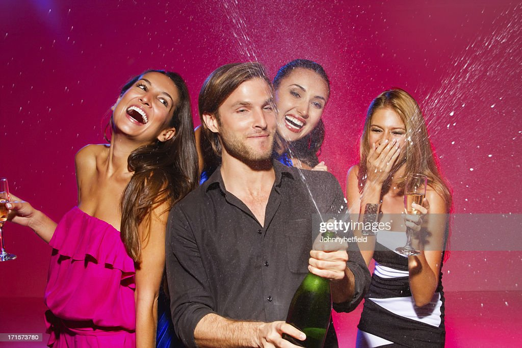 Friends Celebrating With Drinks At Nightclub : Stock Photo