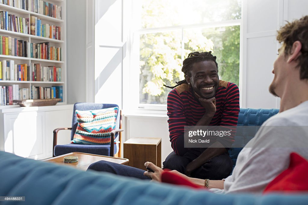 Friends chatting at home : Stock Photo