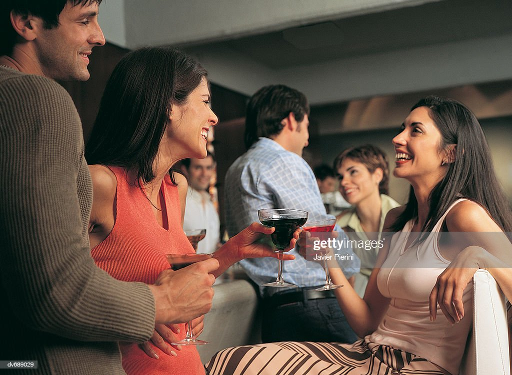 Friends Chatting in a Bar : Stock Photo
