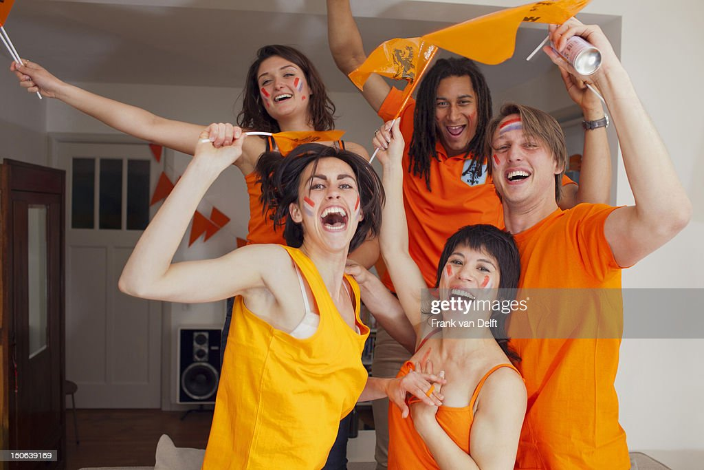 Friends cheering for sports together : Stock Photo