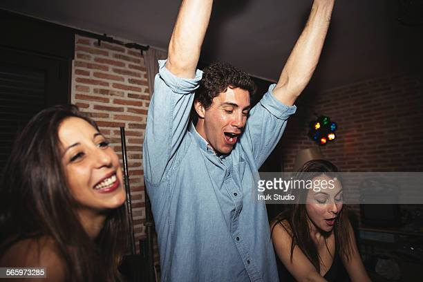 Friends cheering in nightclub