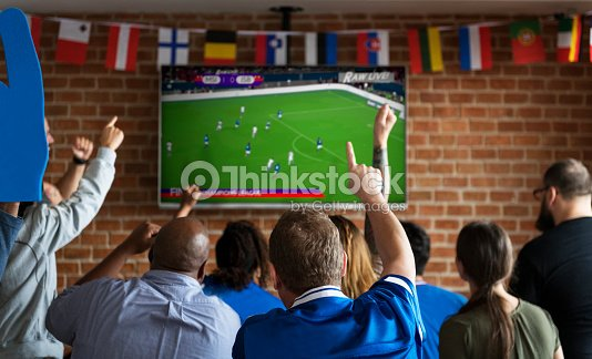 Friends cheering sport at bar together : Stock Photo