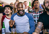 Friends cheering sport at bar together ***These graphics are derived from our own 3D generic designs. They do not infringe on any copyright design.