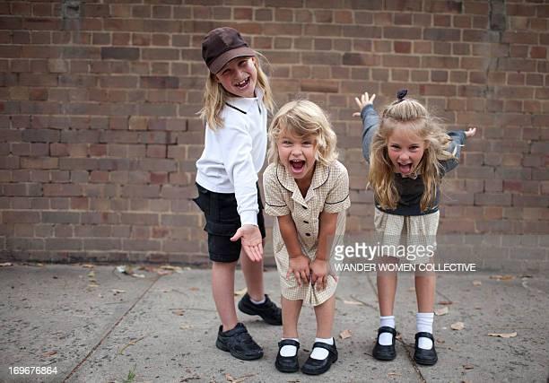 Friends clowning around in school playground