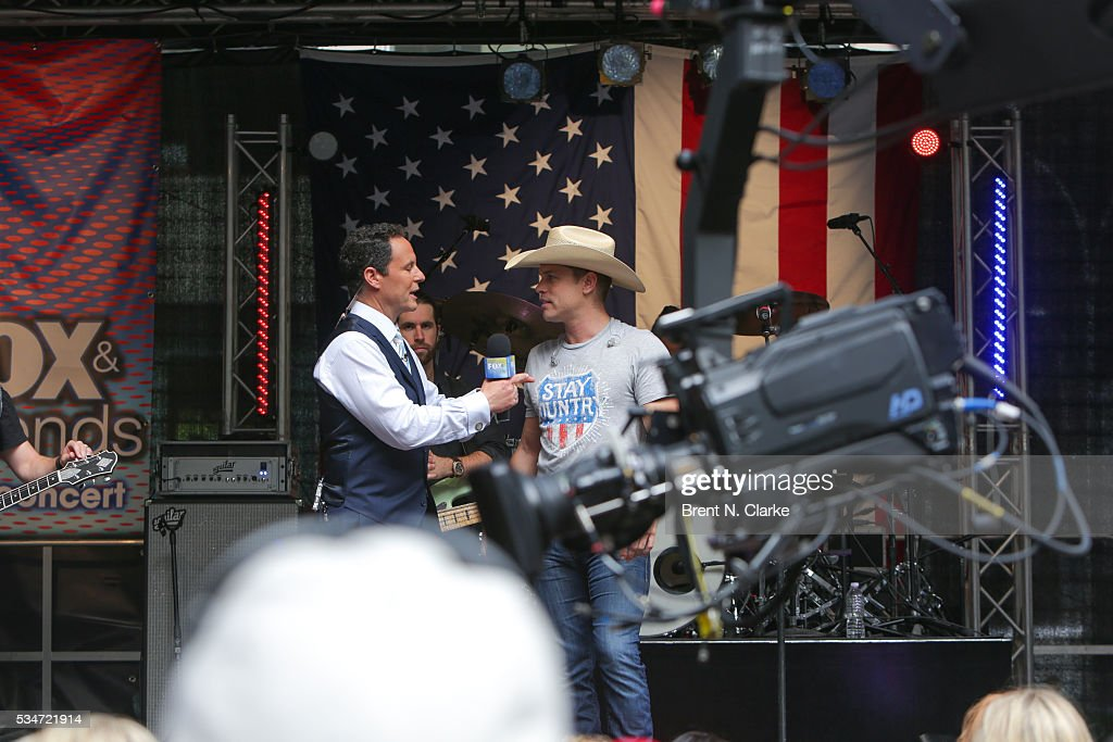 'FOX & Friends' co-host Brian Kilmeade (L) speaks with recording artist <a gi-track='captionPersonalityLinkClicked' href=/galleries/search?phrase=Dustin+Lynch&family=editorial&specificpeople=8612719 ng-click='$event.stopPropagation()'>Dustin Lynch</a> on stage during the 'FOX & Friends' All American Concert Series outside of FOX Studios on May 27, 2016 in New York City.