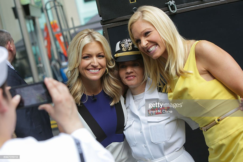 'FOX & Friends' co-hosts Ainsley Earhardt (L) and Anna Kooiman pose for photographs during the 'FOX & Friends' All American Concert Series outside of FOX Studios on May 27, 2016 in New York City.