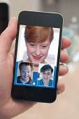 3 friends communicating online, displayed on phone