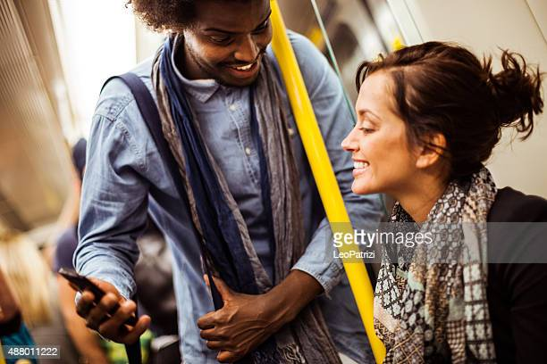 Friends commuting together in subway train