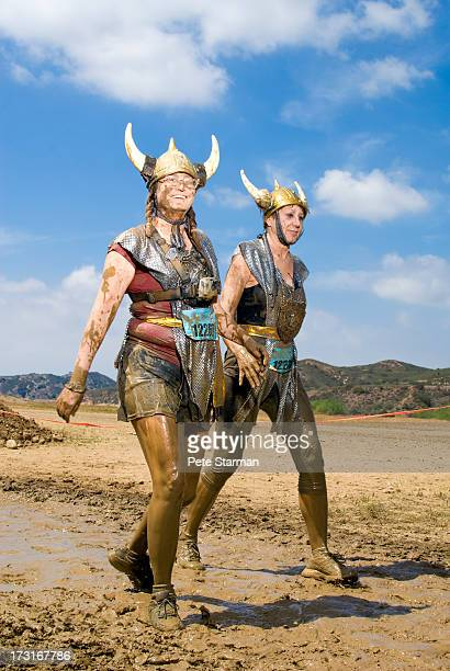 Friends competing in a Mud Run (55-65) yrs old.