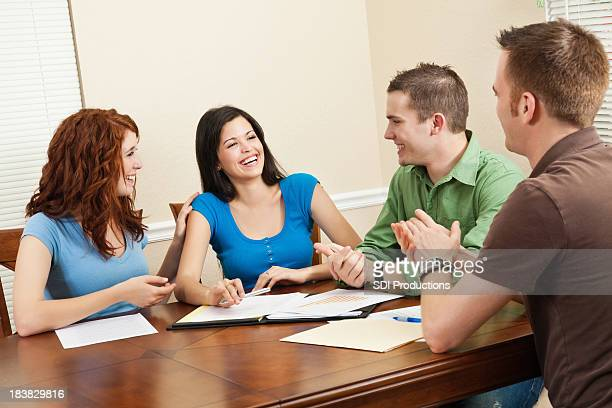 Friends Congratulating Friend During Study Group Time
