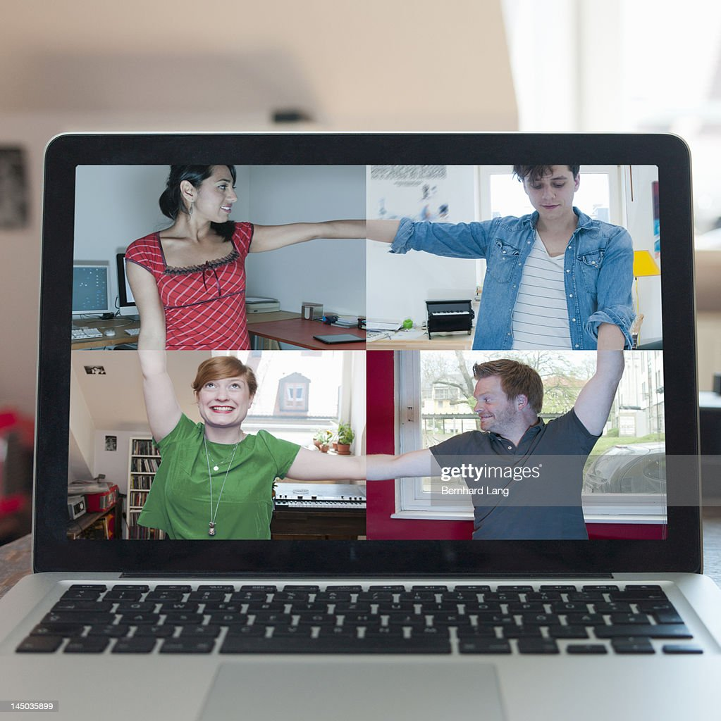 4 friends connecting online, displayed on laptop : Stock Photo