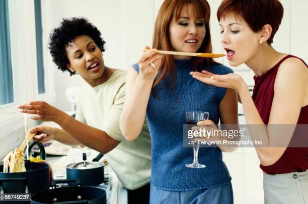 Friends cooking in kitchen