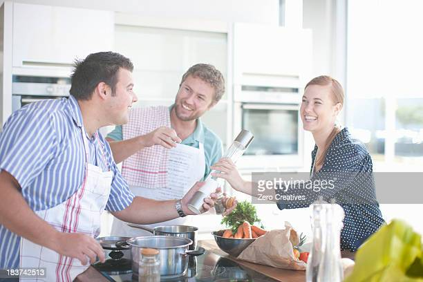 Friends cooking together in kitchen