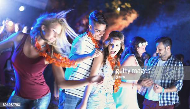 Friends dancing at a party.