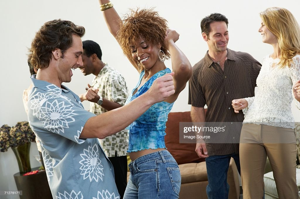Friends dancing at a party : Stock Photo