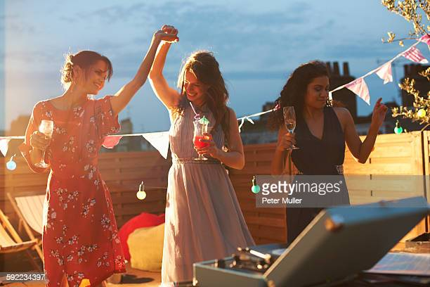 Friends dancing at early evening party