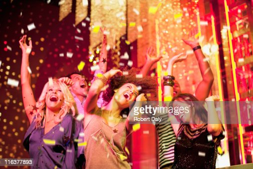Friends dancing at nightclub : Stock Photo