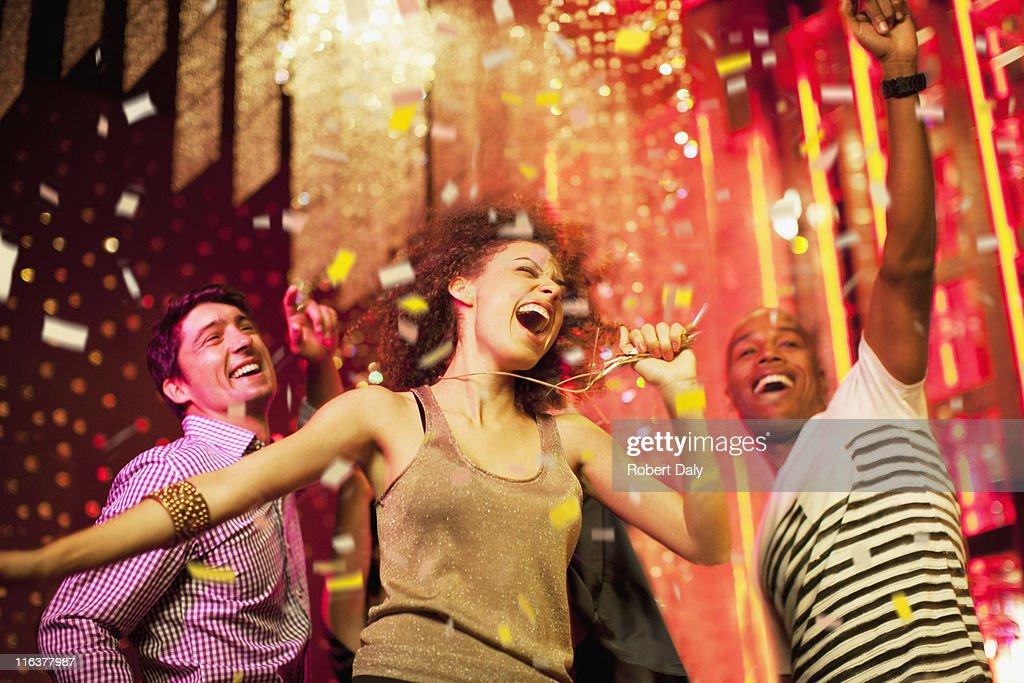 Friends dancing at nightclub : Stock Photo
